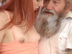Chick\'s shaved pussy is fingered by old man and son in turn