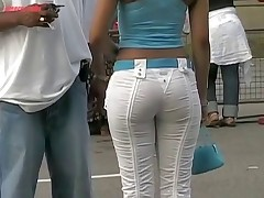 The charming bimbo in the denim hot pants of the white color was spied in the streets
