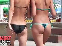 The mind blowing hot bikini butt is invitingly shaking when gal is walking along beach